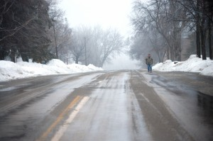 Man walking road in Ashby, MN