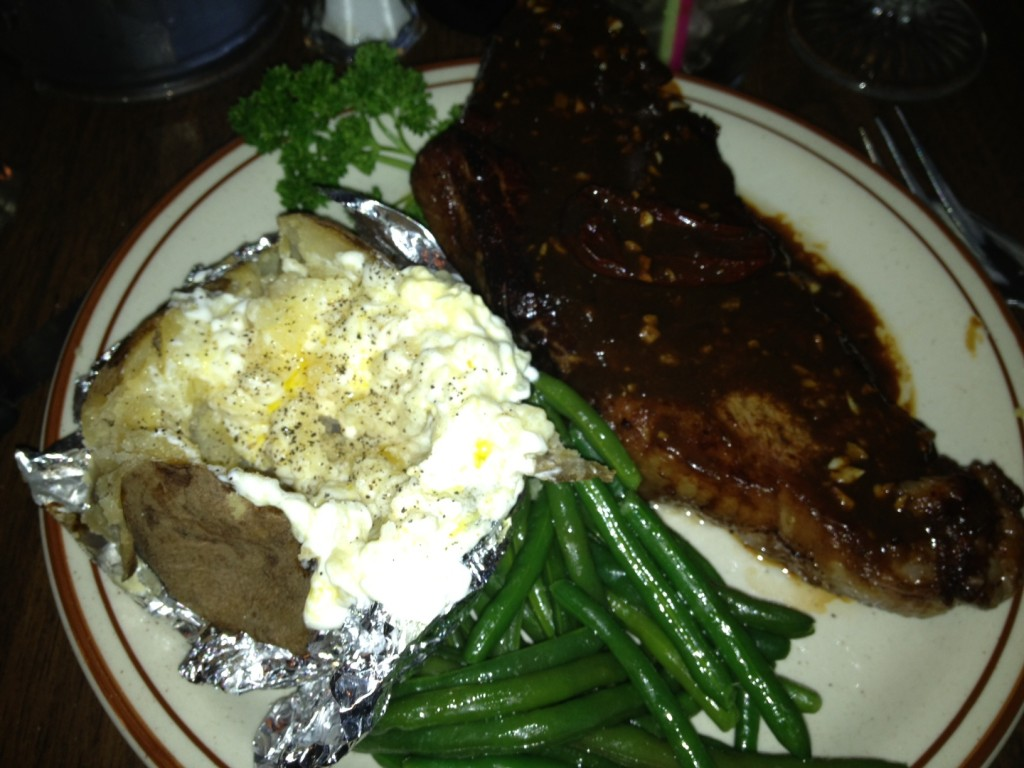 Dinner at Frontier - 16 oz. Cajun blackened New York Strip with a huge potato and green beans.