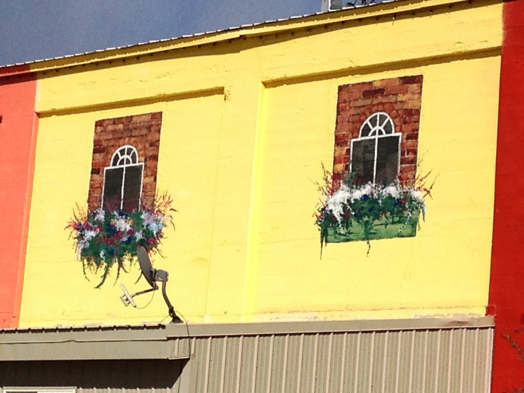 Old Sugar Mill Market - all of the windows and flowers are hand painted