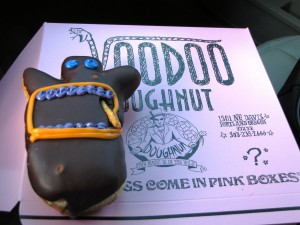 The Voodoo Doll - Raised yeast doughnut filled with raspberry jelly topped with chocolate frosting and a pretzel stake!