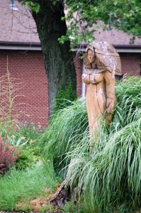 Wooden sculpture in a yard across from Daffin's in Sharon, PA