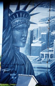 Closeup of Tim Martin mural that is at bottom of sculpture