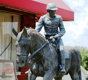 Horse and rider outside of Rebecca Ruth Candy Shop in Frankfort, Kentucky