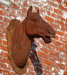 A rustic horse head on a building in downtown Lexington