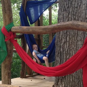 Grandson Landen hangs in a canopy in the tree house