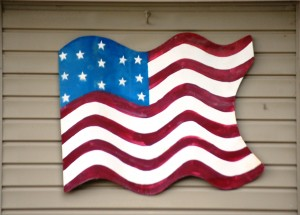 A nice handcrafted flag decorates a house in Nebraska City