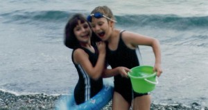 Daughters play on the beach of the Pacific Ocean in Saga-no-Seki, Japan in 1989