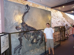 Seth with a dinosaur fossil at Dinosaur National Monument in Dinosaur, Utah