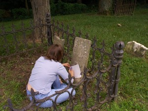 Amaree taking an etching of the grave marker of her great-great-great-great grandfather Joseph Hanks in Quincy, Illinois.