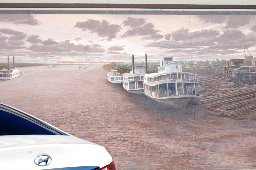 A mural depicting Riverboats on the Ohio in Jeffersonville, IN by Robert Dafford