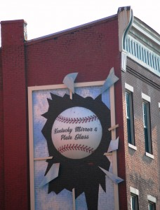 Giant Baseball breaking a Window in downtown Louisville