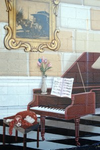 Detail of piano portion of mural on Old Town Liquors in Louisville